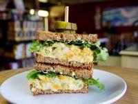 bench market egg sandwich with a pickle garnish