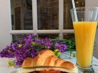 croissant sandwich and juice from Petrasek Bakery