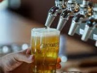 beer being poured at Slackwater Brewing