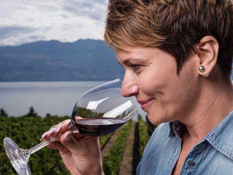 female tasting wine at Quails Gate Winery
