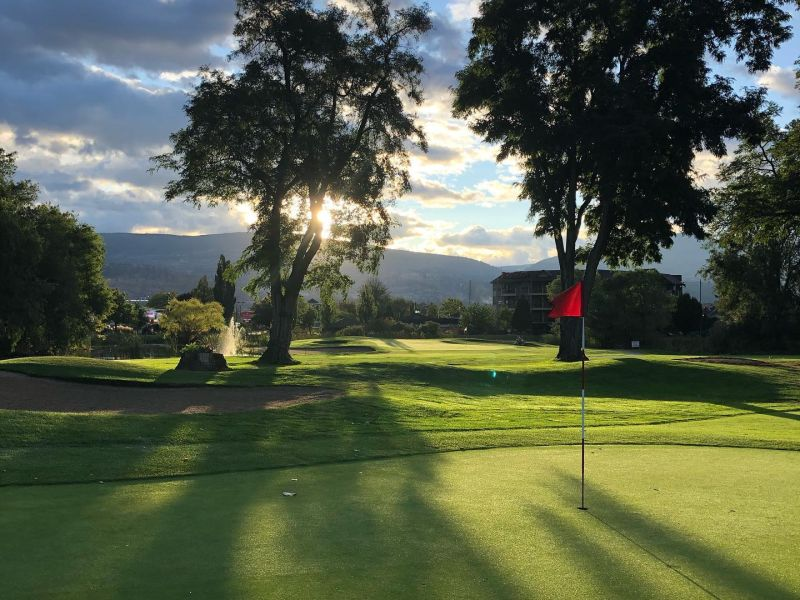 Penticton Golf & Country Club sunlight through trees on a green