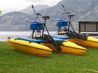 sea legs water bikes bikes on grass in front of skaha lake
