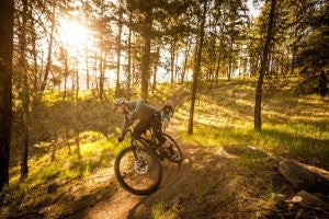 Women riding a mountain bike on the trails
