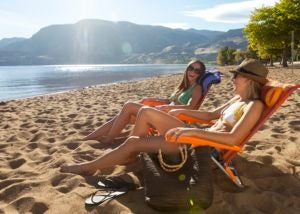 Girls enjoy a sunny day at Skaha beach in Penticton, BC