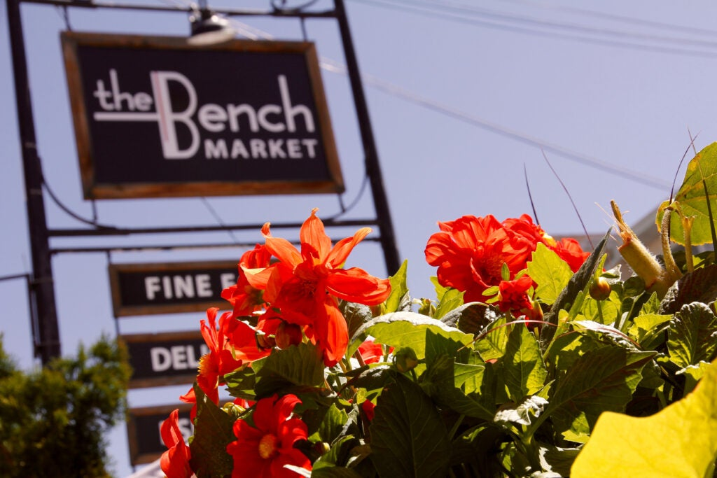 The Bench Market - Street sign with flowers in foreground