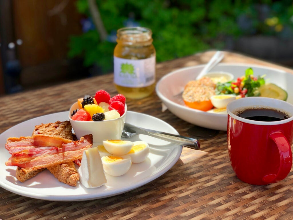 Brunch plates and coffee cup on The Bench Market's patio